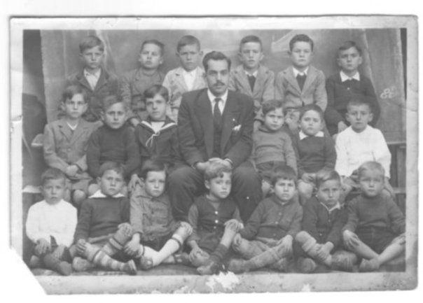 Niños y Maestro de escuela