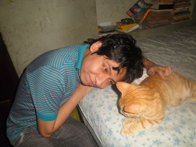 Yashaii Moran and her cat Chirumino